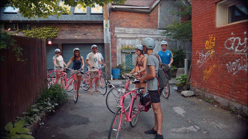 biking in montreal in an alleyway